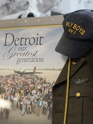 """A display of World War II memorabilia from the documentary """"Detroit the Greatest Generation,"""" includes his dad's """"Fly Boys"""" cap and other items."""