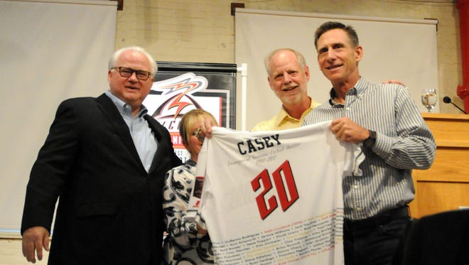 Left to right: Pat O'Connor, president of minor league baseball, Jerry Walker, co-owner of the Volcanoes, and Pat Casey, Oregon State baseball head coach.
