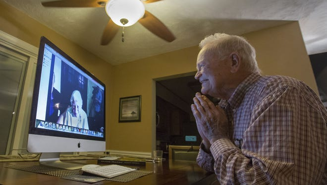 In this photo taken Nov. 6, 2015, Norwood Thomas, 93, talks with Joyce Morris via Skype from his home in Virginia Beach, Va. During World War II, Morris lived in England and was Joyce Durrant, the girlfriend of Thomas, a D-Day paratrooper with the Army's 101st Airborne Division. Morris now lives in Australia. (Bill Tiernan/The Virginian-Pilot via AP)