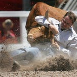 Shawn Basinger of Galeton wrestles a steer during Cheyenne Frontier Days in 2006.