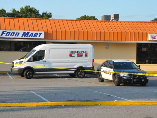 Melbourne police and crime scene technicians on scene at the Sunoco Food Mart at the intersection of Babcock Street and Eber Blvd. across from Palm Bay High School for a shooting in the Sunoco parking lot early Friday a.m.