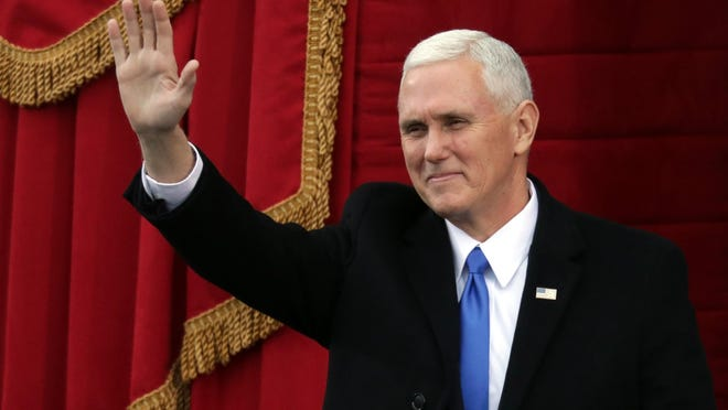 U.S. Vice President-elect Mike Pence waves on the West Front of the U.S. Capitol on Jan. 20, 2017, in Washington, D.C.