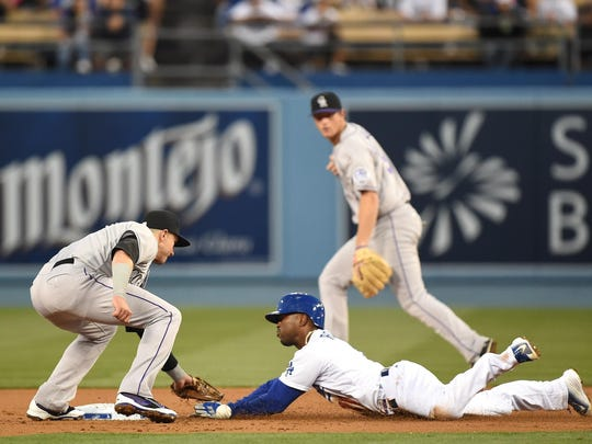 Jimmy Rollins of the Dodgers steals second base against the Rockies on April 17. It was a rare site as the Dodgers have the fewest steals in the Major Leagues with 19.
