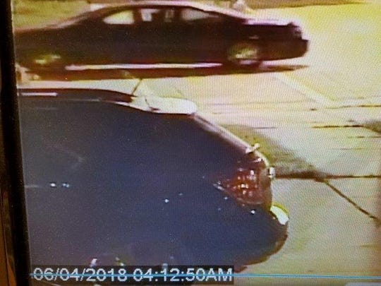 Pictured is the black vehicle suspects were seen loading