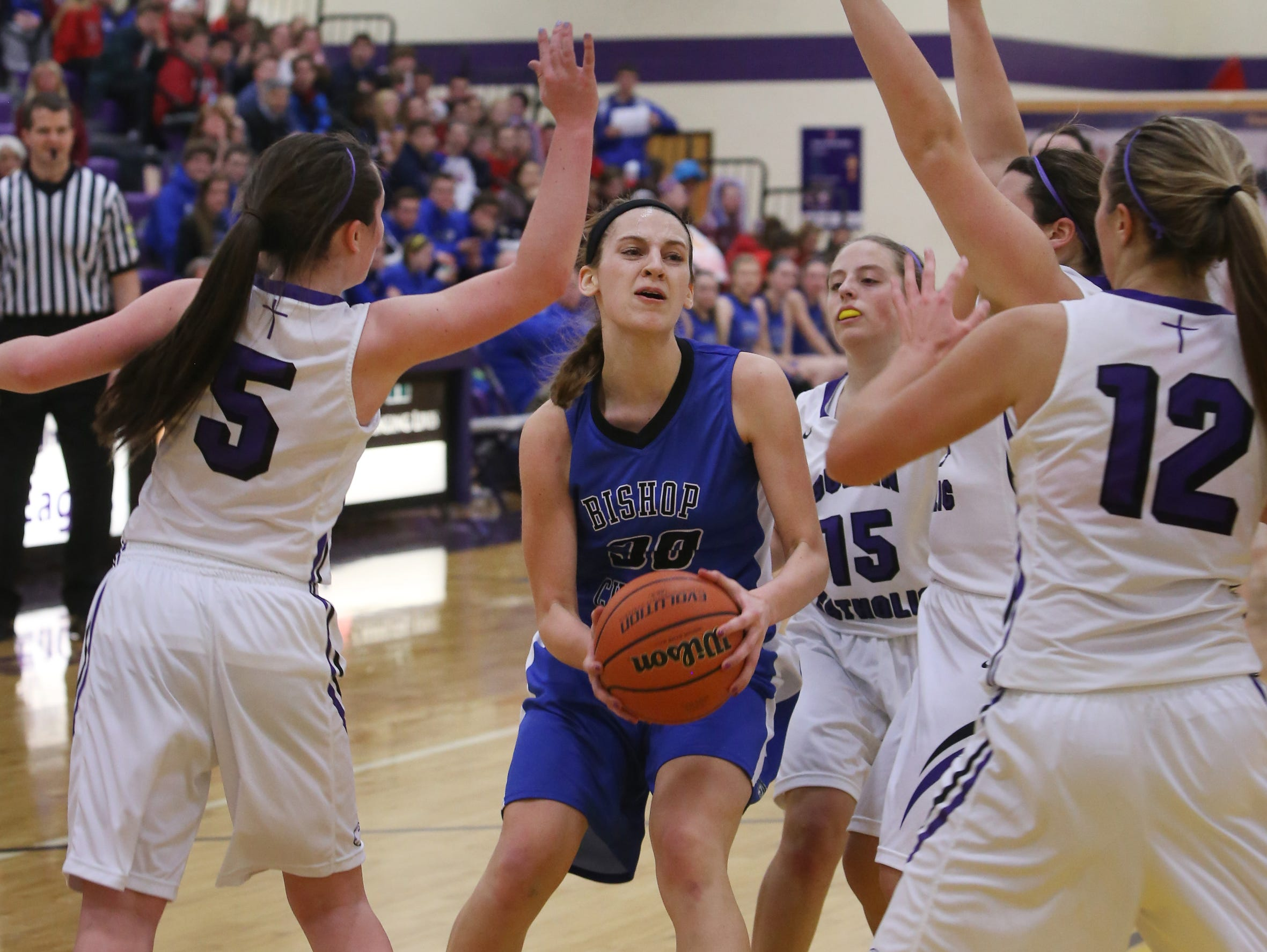 Bishop Chatard's Anna Logan, the game's high scorer with 17 points, is guarded by four Golden Eagles (from left), Sarah Yount, Tori Sullivan, Annamarie Augustinovicz, and Kristy Thiem, during the Trojans girls' 92-41 blowout over Guerin Catholic High School in Noblesville on Friday, Jan. 9, 2015.