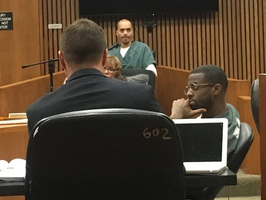 Vincent Smothers testifies in Wayne County Circuit Court on Monday, March 19, 2018, as defense attorney Michael Dezsi, left, and Thelonious Searcy, right, look on.