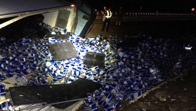 Busch beer covers Interstate Highway 10 in Okaloosa County, Florida, on Wednesday, March 7, 2018, after the driver of a semi truck lost control and rolled over, spilling its cargo.