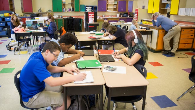 Students do class work at Inspire Academy, a public charter school in Muncie offering grades K-5, in this file photo.