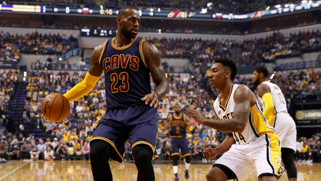 Cleveland Cavaliers forward LeBron James (23) is guarded by Indiana Pacers guard Jeff Teague (44) in game four of the first round of the 2017 NBA Playoffs at Bankers Life Fieldhouse.