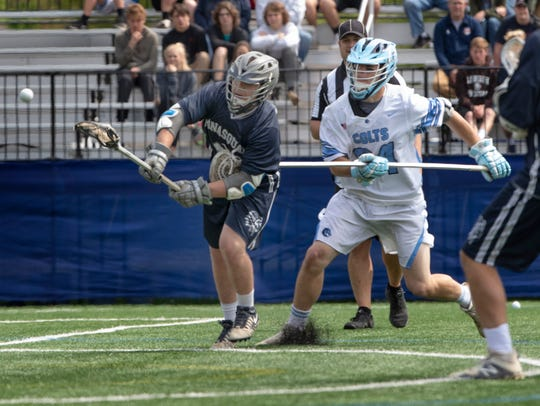 Manasquan's Canyon Birch puts in a first half goal.
