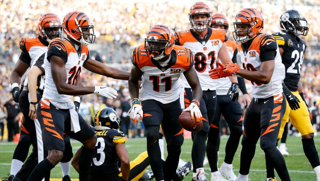 Cincinnati Bengals wide receiver Brandon LaFell (11) begins to celebrate after a touchdown catch in the first quarter of the NFL Week 7 game between the Pittsburgh Steelers and the Cincinnati Bengals at Heinz Field in Pittsburgh on Sunday, Oct. 22, 2017.