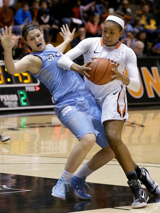 FILE - In this Feb. 6, 2015, file photo, Princeton forward Leslie Robinson, right, looks to take a shot as she collides with Columbia forward Camille Zimmerman during an NCAA college basketball game in Princeton, N.J. Robinson, who is the niece of President Barack Obama, and Princeton are scheduled to face Green Bay in the first round of the NCAA women's tournament on Saturday. (AP Photo/Mel Evans, File)