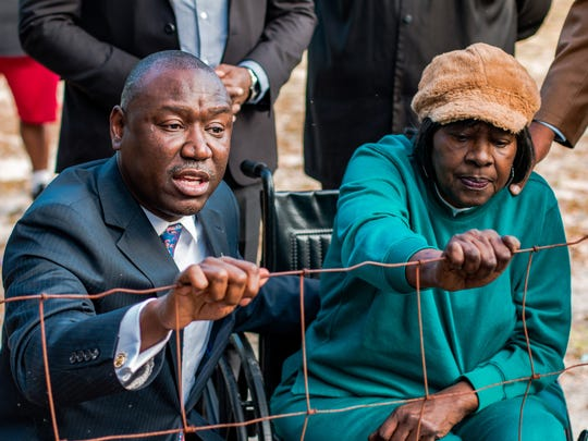 Ben Crump and Gwen Lillian Thomas in Camilla, Ga., on Dec. 22, 2017, at Camilla's Oakview Cemetery by the fence segregating blacks from whites in the city-owned cemetery.