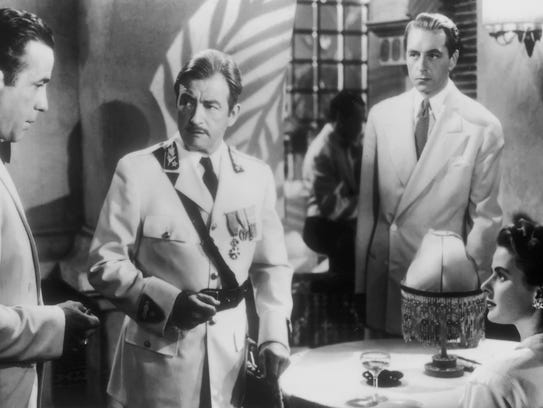 Humphrey Bogart (from left), Claude Rains, Paul Henreid
