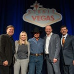 """Lon Helton, from left, Cindy Mabe, George Strait, Louis Messina, and Rick Arpin appear during the """"Strait to Vegas"""" press conference held at MGM Grand Resort and Casino on Tuesday, Sept. 22, 2015, in Las Vegas. (Photo by Al Powers/Powers Imagery/Invision/AP)"""