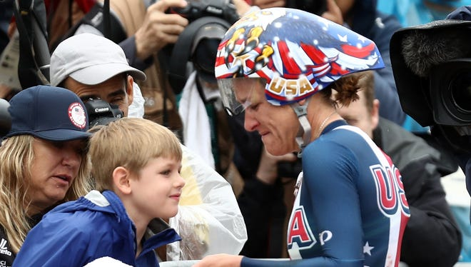 American Kristin Armstrong, right, celebrates with her son Lucas William Savola after winning gold in the women's individual time trial Wednesday on Day 5 of the Rio 2016 Olympic Games at Pontal in Rio de Janeiro, Brazil.