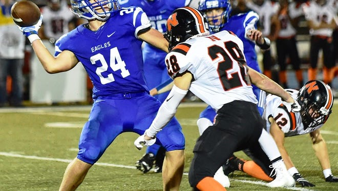 Lakeland's Jason Wooster (left) tries to get off the throw in front of Northville's Ian Rachelson.