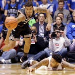 Louisville's Quentin Snider, left, and Duke's Brandon Ingram chase a loose ball during the first half of an NCAA college basketball game in Durham, N.C., Monday, Feb. 8, 2016. (AP Photo/Gerry Broome)