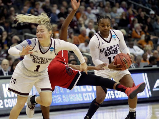 Mississippi State guard Blair Schaefer (1) is called for a foul against North Carolina State forward Chelsea Nelson, center, when setting a pick for teammate Roshunda Johnson, right, during the second half of a women's NCAA college basketball tournament regional semifinal game, Friday, March 23, 2018, in Kansas City, Mo. (AP Photo/Orlin Wagner)