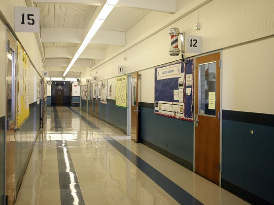 The hallways of Lord High School at MacLaren Youth Correctional Facility in Woodburn Friday, April 11, 2014. The school was among eight buildings named in a lawsuit accusing the Oregon Youth Authority of exposing workers and students to asbestos.