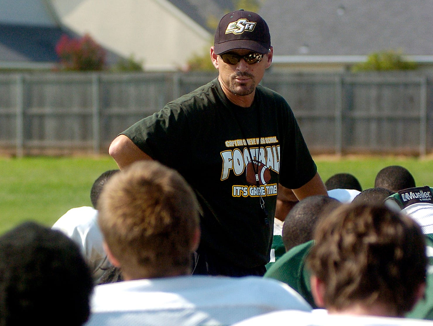 Captain Shreve coach Richard Lary talks to his players during practice at the school.