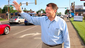 Former South Dakota Gov. Mike Rounds waves to motorists on the corner of 26th and Minnesota in Sioux Falls as they pass by on their way to work, as he campaigns during the state's primary election Tuesday.