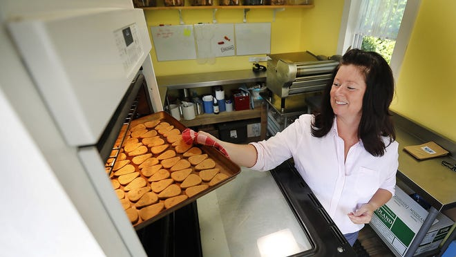 Lauren Carberry, of Weymouth, makes artisan dog biscuits and jerky in her backyard kitchen.