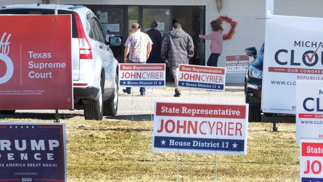 Cedar Creek Methodist Church's frontage is filled with campaign signs on Election Day as voters head to cast a ballot on Nov. 3.