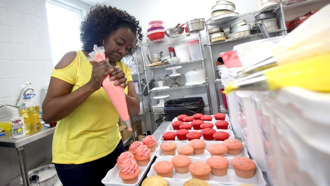 Owner Karren Walls works in the kitchen at Sweethouse Bakery in Shelby.