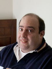 Adam Resnick, an autistic man who has just moved out