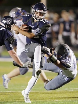Bay Port quarterback Isaac Krause (12) was the co-offensive player of the year in the FRCC.