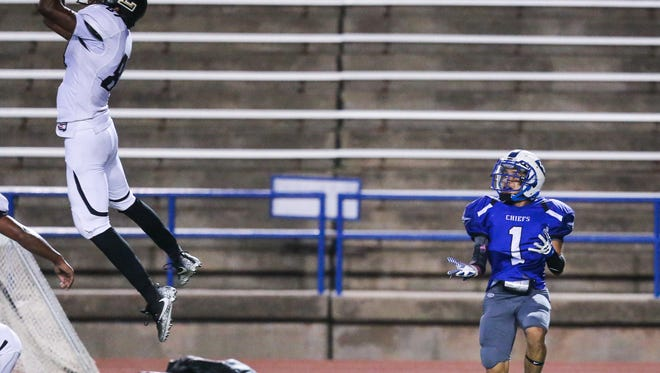 Lubbock's Kristian Coleman jumps to intercept a ball intended for Lake View's Isaiah Moreno Friday, Oct. 20, 2017, at San Angelo Stadium.