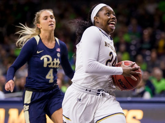 Notre Dame's Arike Ogunbowale (24) drives in on a fast break in front of Pittsburgh's Cassidy Walsh (4) during the first half of an NCAA college basketball game Thursday, Jan. 3, 2019, in South Bend, Ind. (AP Photo/Robert Franklin)