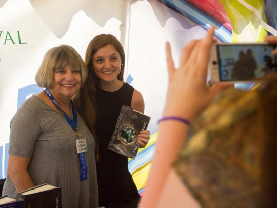 Amy LaFontaine of Melbourne has her photo taken with one of her favorite authors, Cinda Williams Chima, left, on Saturday at the Southwest Florida Reading Festival in downtown Fort Myers.