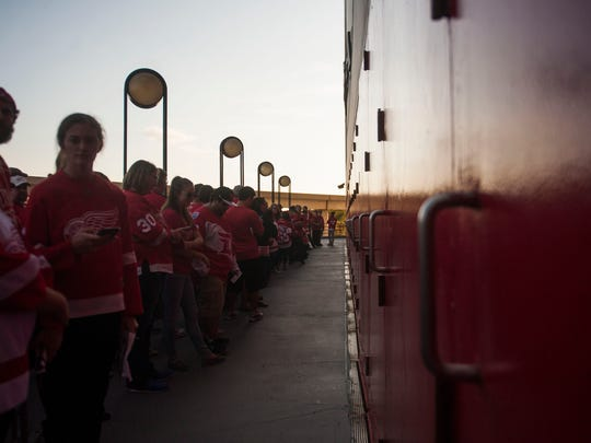 Detroit Red Wings' fans line up and wait for the doors of Joe Louis Arena to open on Oct. 17, 2016.