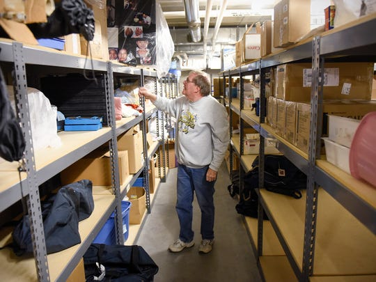 HELPS Program volunteer Mert Eckes looks through medical equipment collected for an upcoming trip to Guatemala Saturday, March 11, in St. Cloud.
