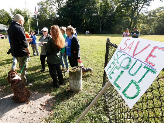 Residents gather for a protest demonstration at Scout Field in Bronxville on Saturday, September 30, 2017.