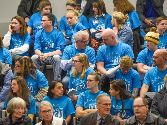 People in support of a proposed tobacco ordinance wear matching t-shirts Monday, Nov. 6, during the St. Cloud City Council meeting at city hall.