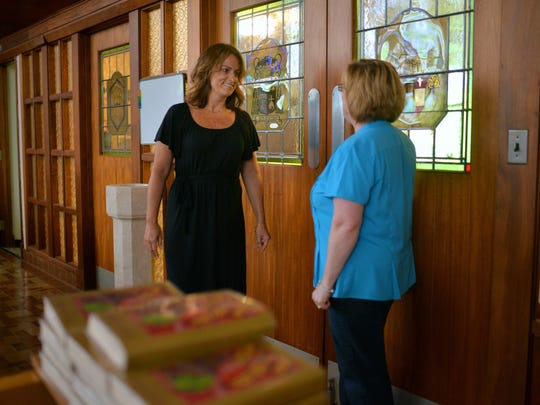 Our Lady of Mercy Academy's new principal Brooke Coyle, of Vineland, talks with OLMA director of development and marketing Mary Jane Kinkade, of Milmay, (from left) inside the school's chapel, Tuesday, Jul. 19, 2016 in Newfield.