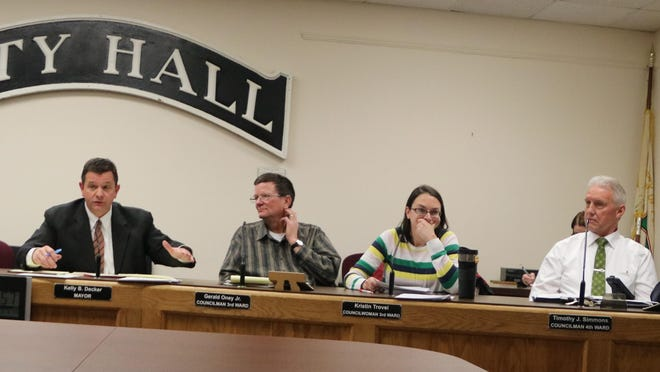 Mayor Kelly Decker, second from left, claimed thatappointing an attorney was his privilege as mayor, and the attorney's role is primarily to work with the mayor. Council members Lisa Randazzo, left, agreed, as did Geri Oney and Kristin Trovei, third and fourth from left. Tim Simmons and Stan Siegel, third and fourth fromright, disagreed.