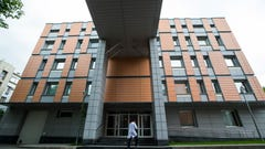 "FILE - In this Tuesday, May 24, 2016 file photo, an employee walks into the building of the Russia's national drug-testing laboratory in Moscow, Russia. Vladimir Putin's spokesman says Russia is ""optimistic"" ahead of a World Anti-Doping Agency ruling Tuesday Jan. 22, 2019, on whether the country's authorities met demands to turn over lab data. The WADA executive committee reinstated Russia's anti-doping agency in September 2018 on condition the country turned over data from a Moscow laboratory. (AP Photo/Alexander Zemlianichenko, File)"
