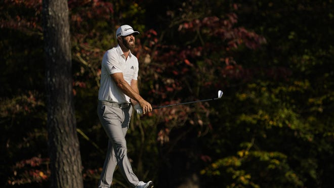Dustin Johnson watches his second shot on the 11th hole during the third round of the Masters Saturday, Nov. 14, 2020, in Augusta.