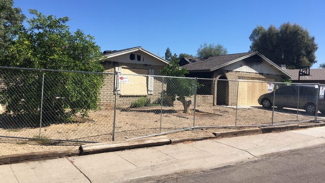 A fence has been put up around the Glendale house near 51st and Peoria avenues where a house fire broke out early April 5, 2017, killing the family of four who was inside.