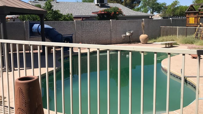Police say a 4-year-old boy used a chair to open a pool gate on May 28, 2018, in Peoria. The boy drowned.