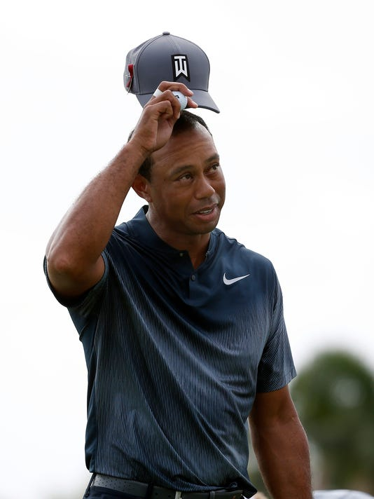 Tiger Woods tips his cap after finishing on the ninth hole during the first round of the Honda Classic golf tournament, Thursday, Feb. 22, 2018, in Palm Beach Gardens, Fla. (AP Photo/Wilfredo Lee)