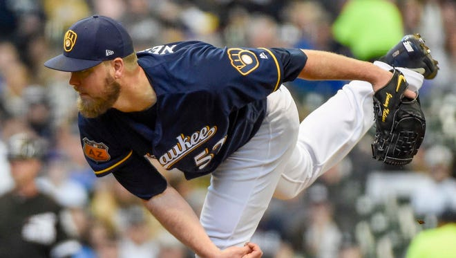 Jimmy Nelson tries to help the Brewers gain a split in the series on Sunday.