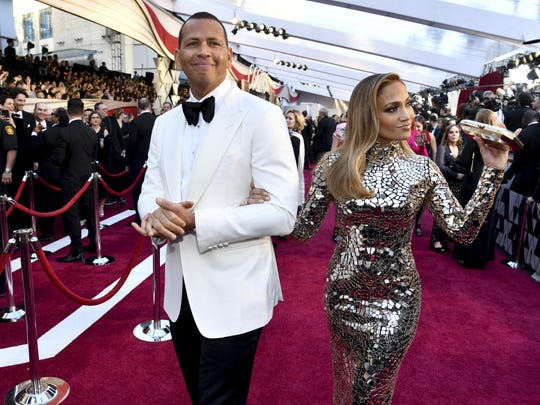 Alex Rodriguez, left, and Jennifer Lopez arrive at
