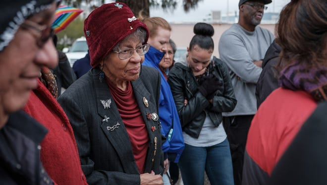 Dorris T. Hamilton, retired educator and civil rights activist, listens to a blessing given before the 2017 Martin Luther King Day march in downtown Las Cruces.