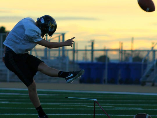 Alamogordo freshman kicker Brett Money kicks a field goal during practice Wednesday evening at Tiger Stadium.