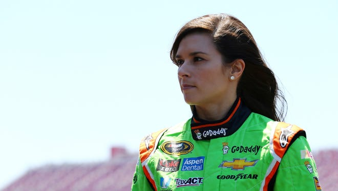 Danica Patrick, driver of the #10 GoDaddy Chevrolet, stands in the garage area during practice for the NASCAR Sprint Cup Series GEICO 500 at Talladega Superspeedway on May 1, 2015.